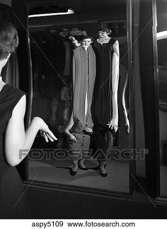 Stock Photograph Of 1950s Two Young Women Looking At