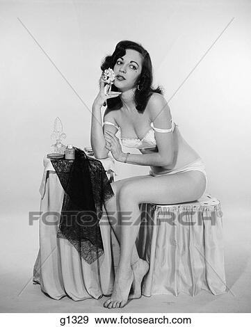 Stock Photograph of 1940s 1950s pensive young woman wearing bra and ...