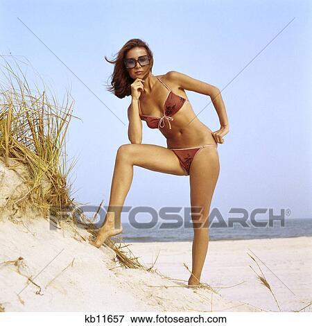 Picture of 1970s woman wearing two piece string bikini ...