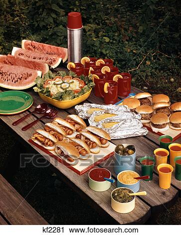 Stock Photography of 1950s picnic table top full of food ...