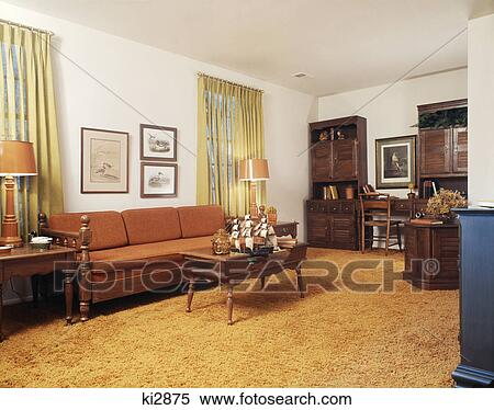 stock image of 1970s living room with orange couch shag. Black Bedroom Furniture Sets. Home Design Ideas