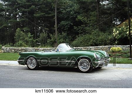 stock images of 1950s 1954 vintage green corvette sport car with convertible top down outdoor. Black Bedroom Furniture Sets. Home Design Ideas