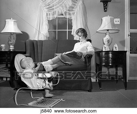 Stock Photography Of 1950s Teen Babysitter Seated On Sofa