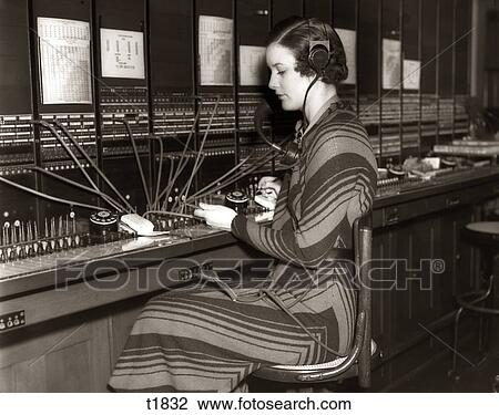 Stock Photo of 1930S Woman Telephone Operator Sitting At ...