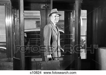 Stock Photo - 1930S 1940S Smiling Businessman In Hat Double Breasted Suit Briefcase Leaving Building Through  sc 1 st  Fotosearch : 1940s door - pezcame.com