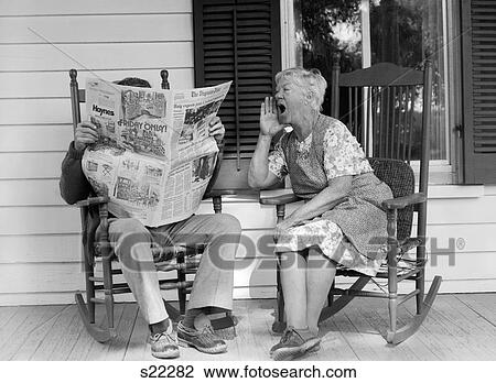 Stock Photo Of 1970s Elderly Couple In Rocking Chairs On