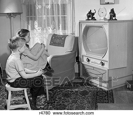 Stock photography of 1950s boy and girl watching tv in - Watch the elephant in the living room ...