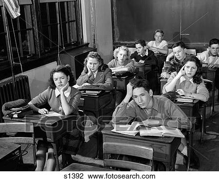 1940s 1950s high school classroom of bored students sitting at desks