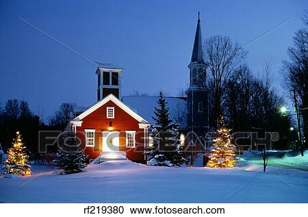Stock Photography   1980S Small Town Winter Snow Scene Church Building  Decorated With Colorful Christmas Lights