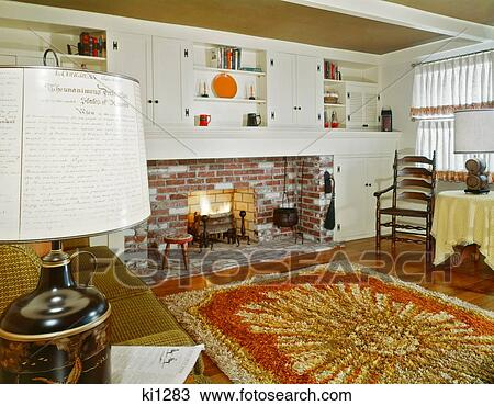 Stock Photo   1960S Interior Of Living Room With Shag Area Rug Fireplace  And Early American
