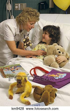 Pictures of 1980S Nurse With Young Patient In Hospital Bed ...