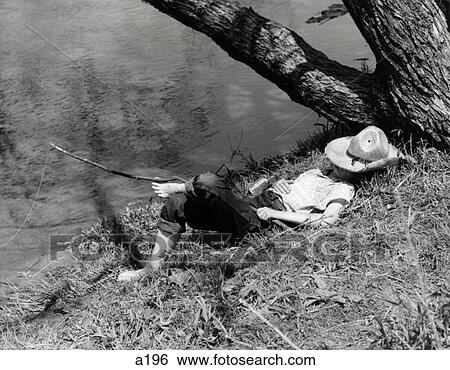 Stock Images Of 1940s Barefoot Boy Sleeping Under Tree
