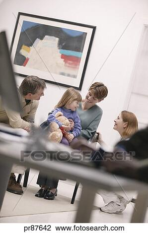 Concerned Family In Hospital Waiting Room