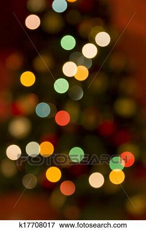 Colourful Circles Of Blurred Light Against Darker Background Vertical