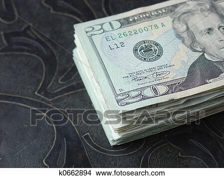 20 dollar bills on table