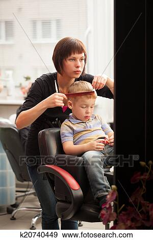 Stock Photograph Of Little Boy Getting A Haircut From Hairdresser