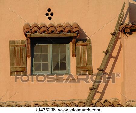 Archivio di immagini casa adobe k1476396 cerca archivi for Tetto in stile ranch