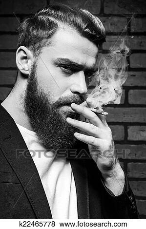 images barbe homme smoking noir blanc portrait de beau jeune homme barbu fumer. Black Bedroom Furniture Sets. Home Design Ideas