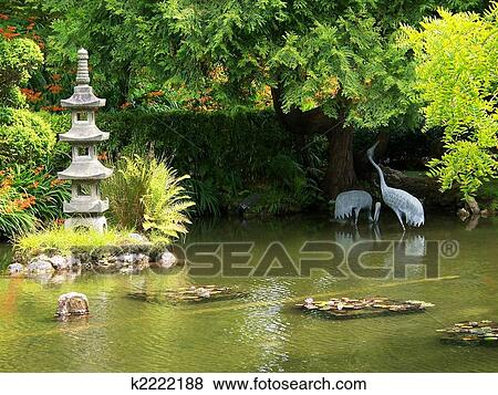 Pictures of crane and pagoda statuary in koi pond k2222188 for Koi pond japanese tea garden san francisco