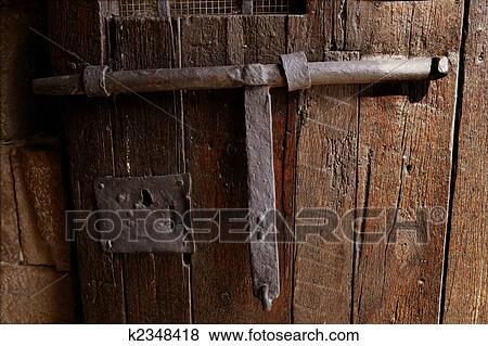 Pictures of Old medieval lock on wooden castle door k2348418 ...