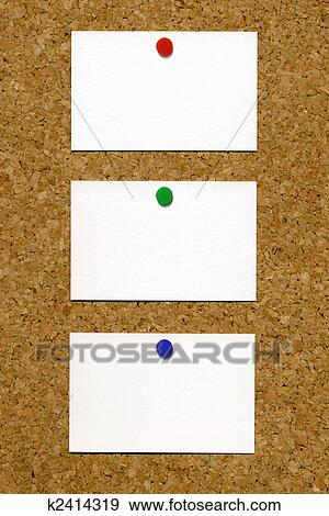 Stock Photograph of Three blank white business cards attached to a ...