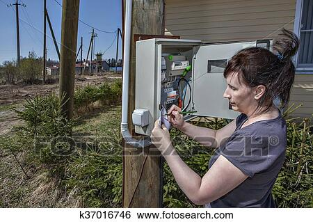 stock images of peasant women writing down electric meter reading stock image peasant women writing down electric meter reading in fuse box fotosearch