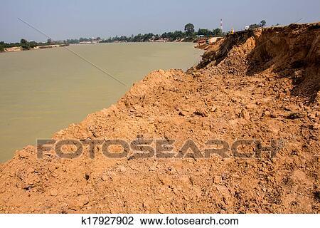 Stock photo of soil erosion by the river k17927902 for Soil erosion in hindi