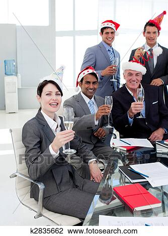Stock Photo of Manager and his team with novelty Christmas hat ...
