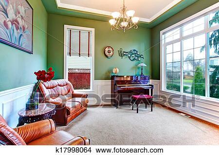 stock foto bezaubern gr n wohnzimmer mit klavier k17998064 suche stockbilder wandbilder. Black Bedroom Furniture Sets. Home Design Ideas