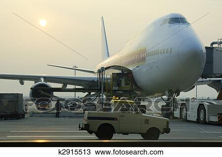 Stock Photo of Loading cargo to airplane k2915513 - Search ...