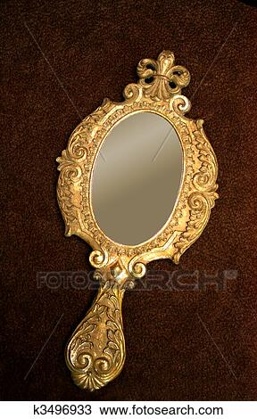 Stock Photo of Old brass hand-mirror k3496933 - Search ... Vintage Hand Mirror Clip Art