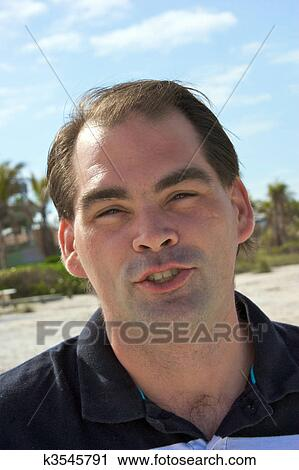 Admirable Stock Photography Of Average Guy On Beach Talking K3545791 Hairstyle Inspiration Daily Dogsangcom