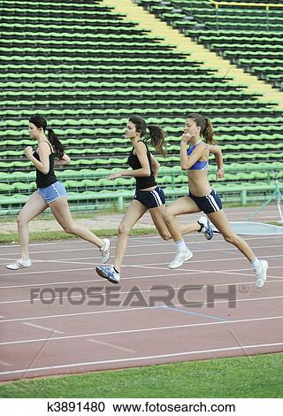 Stock Photography   Girls Running On Athletics Race Track. Fotosearch    Search Stock Photos, Part 96