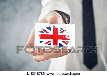 Stock Image of British Businessman holding business card with ...