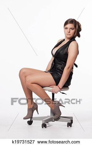 Brilliant Beautiful Young Woman Sitting On Stool Royalty Free Stock Photo