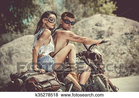 pictures of sexy couple of bikers on the old motorcycle. k35278518