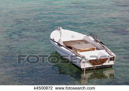 banque de photo petit bateau moteur k4500872 recherchez des images des photographies et. Black Bedroom Furniture Sets. Home Design Ideas