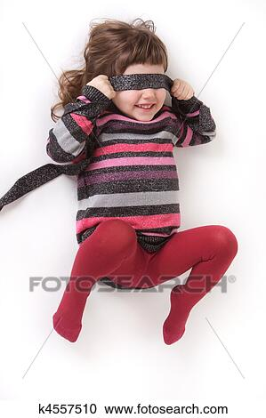Stock photography of little girl in red tights and a for Collant mural francais