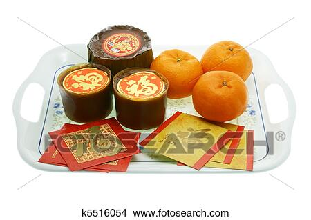 Stock Photo of Chinese New Year rice cakes, oranges and ...