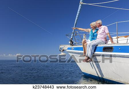 Stock Photo of Happy Senior Couple Sailing on a Sail Boat ...