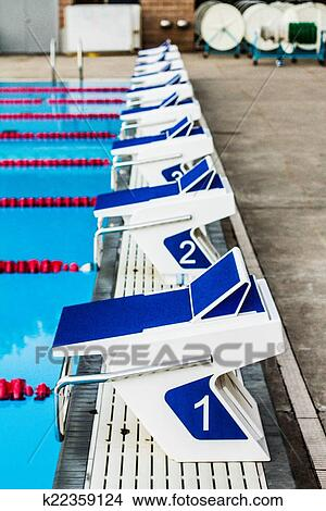stock photo olympic pool starting blocks fotosearch search stock images mural photographs - Olympic Swimming Starting Blocks