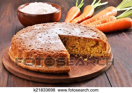 Pictures of Carrot cake on wooden table k21833698 - Search ...