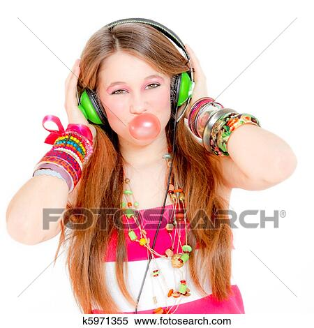 Stock Image of funky girl listening to music and blowing