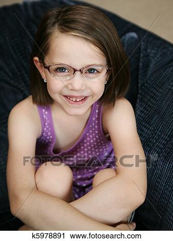 stock photography of cute little girl wearing glasses