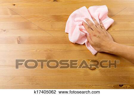 stock foto putzen tisch per rosa lappen k17405062 suche stockfotografie fotodrucke. Black Bedroom Furniture Sets. Home Design Ideas