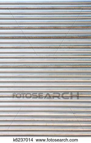 Stock Photo   Worn Metal Garage Door Gate Store Roller Shutter . Fotosearch    Search Stock