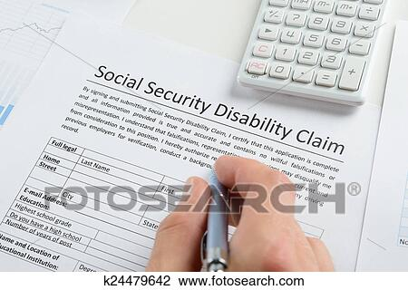 Stock Photo Of Person Hand With Pen Filling Social Security