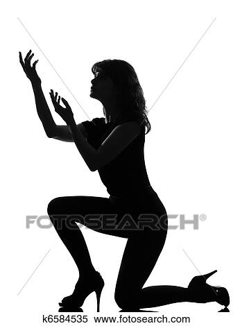 Stock Image of silhouette woman kneel praying imploring k6584535 ...