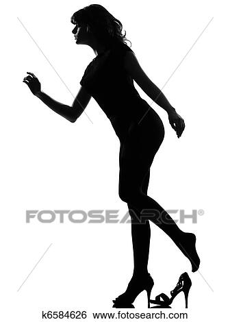 full length silhouette in shadow of a young cinderella woman losing her shoe in studio on white background isolate