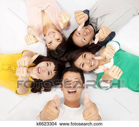 Junge asiatische jugendlich Daumen